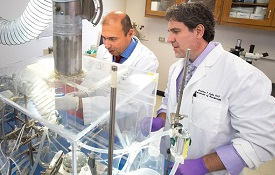 USA researchers Dr. Jonathon Audia, right, and Dr. Diego Alvarez recently developed a model of bacterial sepsis and pneumonia that can aid in the fight against antibiotic-resistant bacteria.