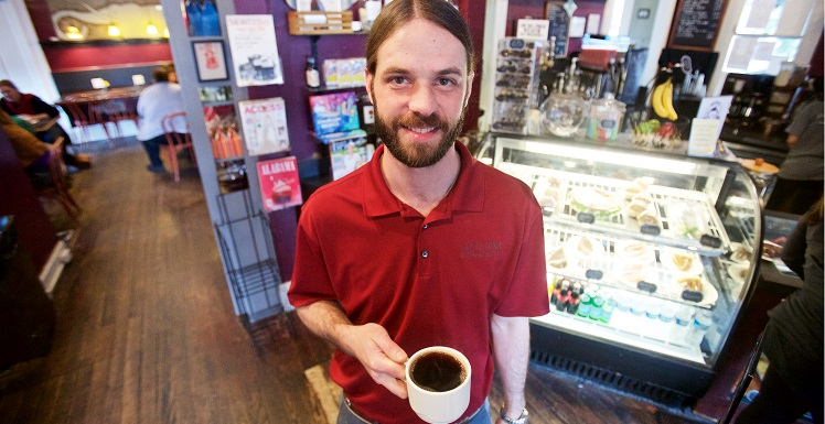 Alan Tolson, a business graduate and owner of Carpe Diem Coffee & Tea Co., said the Springhill coffee house is experiencing double-digit growth. One emerging sector: Churches looking to provide parishioners with coffee before or after service.  data-lightbox='featured'