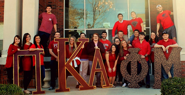 Members of Pi Kappa Alpha and Phi Mu participate in National Wear Red Day at the University of South Alabama.