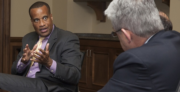 U.S. Assistant Secretary of Commerce Jay Williams, left, talks with USA Mitchell College of Business Dean Dr. Bob Wood and other administrators during a recent visit to campus.
