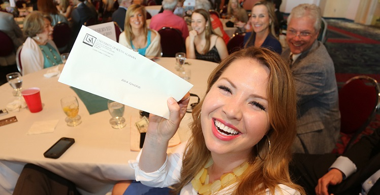 Sara Gonzales holds her envelope as she waits for the ringing of the bell signaling medical school students can find out where they matched during the University of South Alabama College of Medicine's Match Day event March 20, 2015, at the Arthur R. Outlaw Mobile Convention Center.