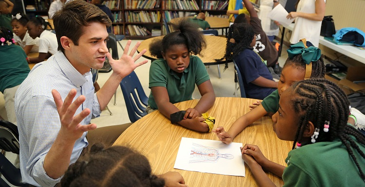 University of South Alabama College of Medicine second-year medical student Jason Snider instructs a group of children at the Boys & Girls Club on Cody Road April 29, 2015. Medical students from the USA College of Medicine have formed a Preventive Medicine Team. The team's mission is to provide education and resources on medically relevant topics to the local community.
