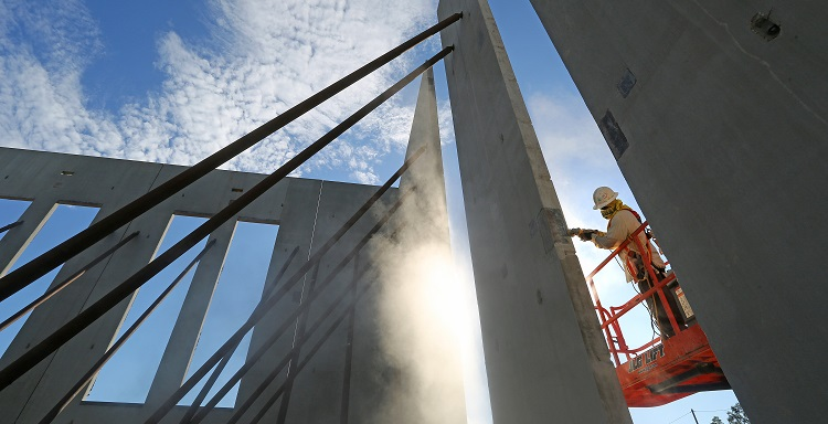 A construction worker is shown on site at the USA Physicians Group Professional Office Building.