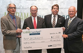The Alabama Launchpad Competition awarded SpectraCyte $87,000 for its research into creating advanced endoscopic imaging technology for cancer detection. From left, Dr. Thomas Rich, USA associate professor of pharmacology; Gov. Robert Bentley; Jim Byard Jr.,  director of the Alabama Department of Economic and Community Affairs; and EDPA President Bill Taylor. Photo courtesy of Gary Tramontina for Alabama Launchpad.