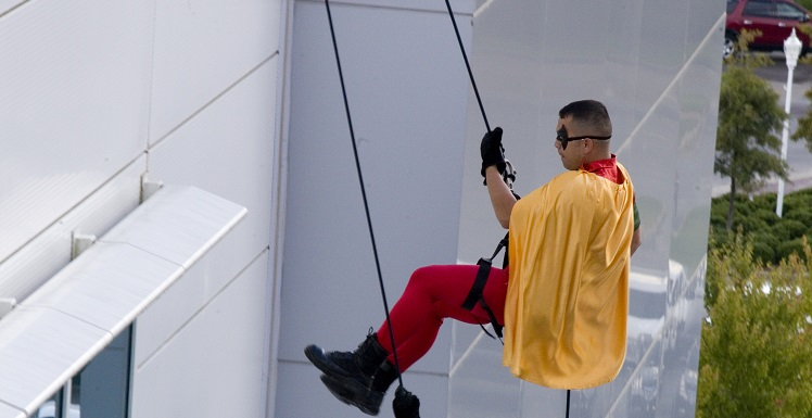 Superheroes from the Mobile Police Department's SWAT team and a few Mobile Fire-Rescue firefighters rappelled down the side of USA Children's & Women's Hospital to help nine children celebrate the end of their cancer treatment.