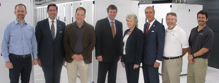 Southern Light recently completed a $5 million, Tier 3 data center at USA. From left are Paul Bullington, Southern Light CFO; Bill Sisson, president and CEO of the Mobile Area Chamber of Commerce; Eric Daniels, Southern Light COO; Andy Newton, Southern Light president and CEO; Lynne Chronister, USA vice president for research and economic development; Mobile Mayor Sandy Stimpson; Roy Franklin, Southern Light Data Center operations manager; and Davis Pilot, Southern Light operations strategic analyst.