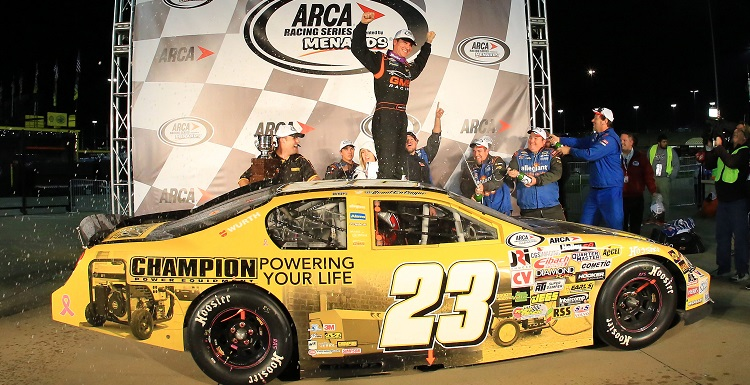 Grant Enfinger, who holds a marketing degree from USA, celebrates at Kansas Speedway in October after winning the 2015 ARCA Racing Series championship.