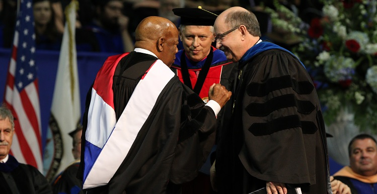 U.S. Rep. John Lewis was the commencement speaker for the University of South Alabama's 2015 Fall Commencement. He is joined on stage, from left, by Dr. Tony Waldrop, USA president, and Dr. David Johnson, provost and senior vice president for academic affairs. data-lightbox='featured'