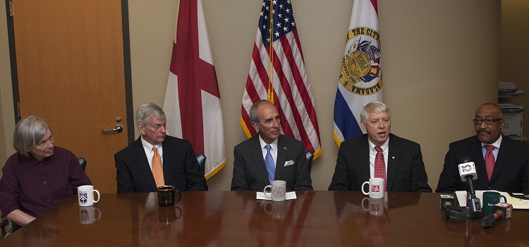 University President Tony G. Waldrop speaks during Mayor Sandy Stimpson's news conference on local universities teaming up with the City of Mobile to promote service learning.  From left, Samantha Church, associate vice president for advancement, Spring Hill College; Dr. Mark Foley, president, University of Mobile; Stimpson; Waldrop; and Dr. James Lowe, president, Bishop State Community College.