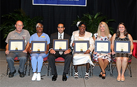 Six University employees are recipients of the 2014 Christie Miree USA National Alumni Association Outstanding Employee Award. These employees, selected from among USA-Team recipients, were recognized for excellent service provided to students, alumni and other constituencies. They are, from left, Deward C. Phillips Jr., maintenance mechanic II, facilities management, USA Medical Center, craft/trades category; Patricia A. Young, custodial worker II, student center, service category; Timothy X. Dexter, assistant director, supply, processing and distribution, Children's & Women's Hospital, technical category; Theresa Clark, ward clerk, high risk OB, Children's & Women's Hospital, clerical category; Angela S. Duffy, nurse manager, burn center, USA Medical Center, administrative category; and Anna K. Gillman, RTN III, STICU, USA Medical Center, professional category.