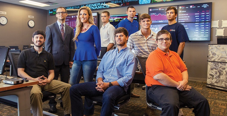 Dr. Kyre Lahtinen, standing top left, is an assistant professor of finance and the faculty advisor to the Jaguar Investment Fund. Participating students for the first semester were, from left, Tyler Yakola, Charis Singleton, Micah Calhoun, Harrison Spruiell, James Lewis, Hayden Welford, Britton Hall and Nicholas Blakley.
