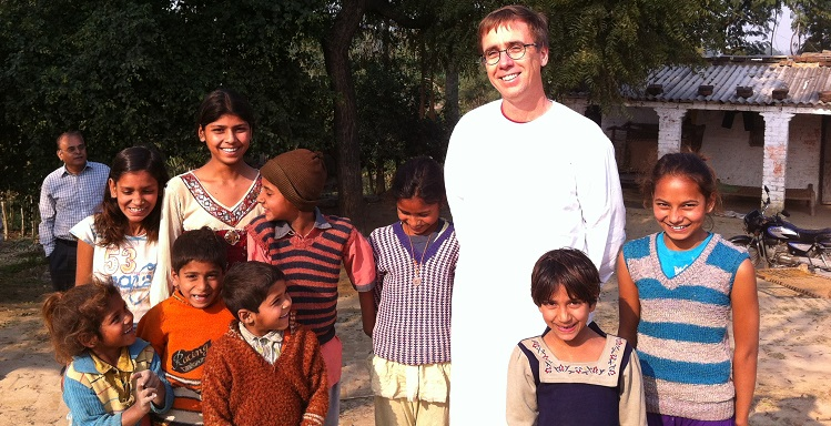 Dr. Harold Pardue, professor of information systems at USA, standing center right in this 2013 photo taken during a trip to India, learned to speak Hindi, the laguage of many of his students.