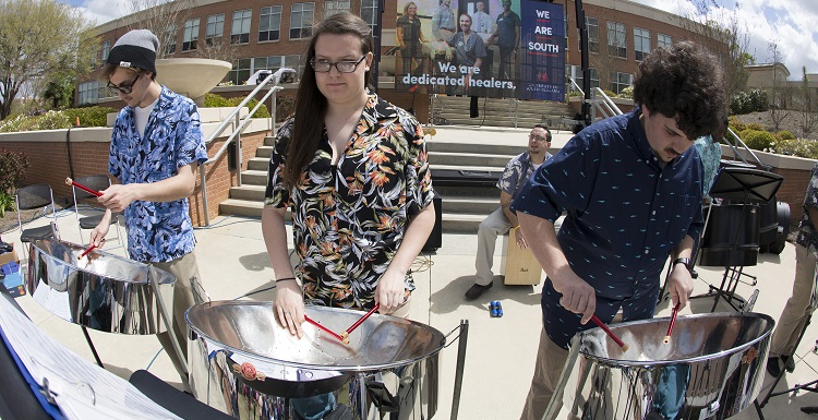 Members of the USA Steel Drum Band play for the University community on Wednesday at USA's Brand Launch outside the Student Center.