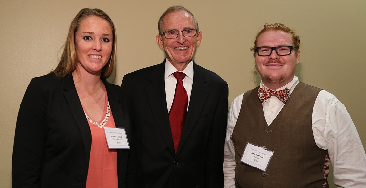 Dr. Keith Harrison, dean of the Graduate School, congratulates Maddie Kennedy, left, and Trenton O'Neal, following their presentations during the University's 3rd Annual 3MT® Competition on Wednesday, March 23.