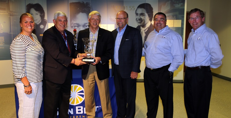 USA President Tony Waldrop, third from left, accepts the Vic Bubas Cup from University of Louisiana at Monroe President Dr. Nick Bruno. Others shown, from left, are USA Associate Athletic Director of Sports Medicine/Senior Women Administrator Jinni Frisbey, Sun Belt Conference Commissioner Karl Benson, USA Director of Athletics Dr. Joel Erdmann and USA Executive Vice President Dr. John Smith. data-lightbox='featured'