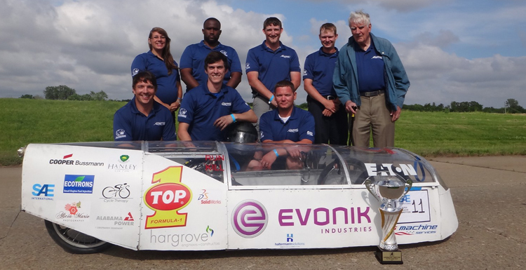 Members of USA's team in the 2015 SAE Supermileage Competition display their Design Report Trophy. Shown, front row from left, Chris Hanley, senior, mechanical engineering; Brandon Troub, senior, mechanical engineering; Daniel Mooney, junior, mechanical engineering; back row from left, Lisa Schibelius, senior, mechanical engineering; Taurean Mulkey, sophomore, computer engineering; Ethan Anderson, junior, mechanical engineering; Dalton Dennis, junior, mechanical engineering; Dr. Frances Donovan, faculty advisor, SAE. Team members not showed: Taylor Gwin, senior, mechanical engineering; Glynn Davies, senior, mechanical engineering; Christian Cobb, senior, mechanical engineering; Patrick Rohr, junior, electrical engineering; Christoph Graf, graduate student, communications; Kristen Gilman, senior, accounting.