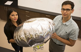 Brandi DePineuli, left, a junior mechanical engineering major from Ocean Springs, Miss., works with Dr. Carlos Montalvo, assistant professor of mechanical engineering, on blimp dynamics where she learned to do mathematics modeling and write code.