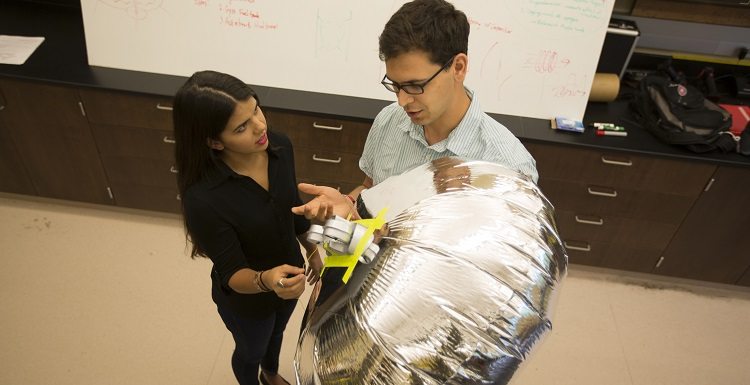 Brandi DePineuil, left, a junior mechanical engineering major from Ocean Springs, Miss., works with Dr. Carlos Montalvo, assistant professor of mechanical engineering, on blimp dynamics where she learned to do mathematics modeling and write code.