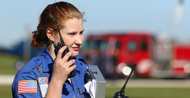 Hannah Beals, a senior in the USA emergency medical services program, listens to radio reports during a disaster drill at Battleship Memorial Park on Nov. 19. Students from the emergency medical services program, the physician assistants program, nursing and the College of Medicine participated in the scenario.
