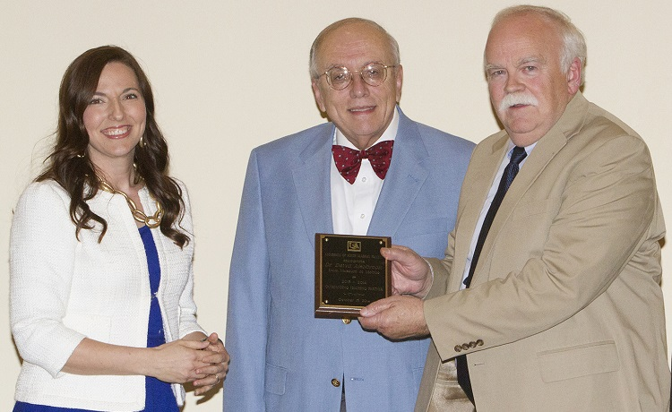 Dr. David Alsobrook, director of the History Museum of Mobile, right, accepts the Outstanding Teaching Partner Award for 2013-2014 from Dr. Clarence Mohr, chair of history, and Dr. Julie Estis, president of the Faculty Senate.