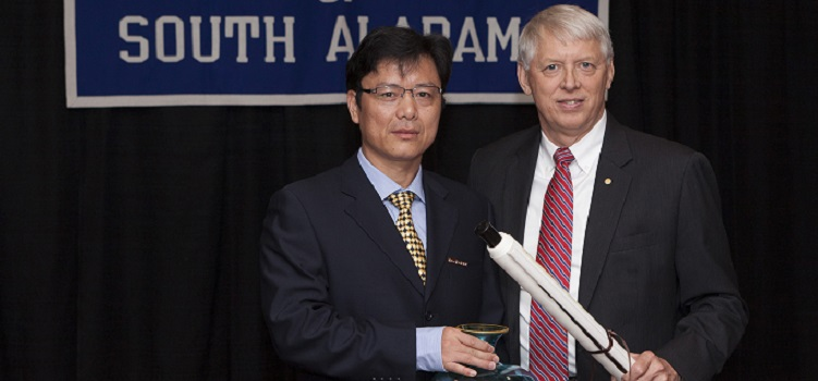 USA President Dr. Tony G. Waldrop, right, welcomes President Zuping Zhu and a delegation from Fuzhou University Zhicheng College in China to the University of South Alabama on Monday, Aug. 11. The two universities cooperate on study abroad programs for students and faculty.