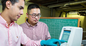 Shenghua Wu received a 2018 FDCG award for his work on innovative asphalt mixtures. In the photo, Omar Tahri, left, a civil engineering junior from Morocco, works side by side with Assistant Professor Dr. Shenghua Wu in the asphalt lab.