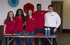 SGA students in front of table