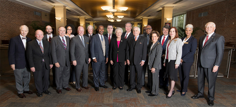 Secondary bannerP​i​ctured from the left:  Honorary Trustee Abe Mitchell with Trustees Dr. Steve Furr; Dr. Scott Charlton; Ron Jenkins; Chandra Brown Stewart; Jimmy Shumock; Jim Yance; Ken Simon - Chair pro tempore; Ron Graham; Governor Kay Ivey - ex officio President and Chair​; Dr. Steve Stokes; Tom Corcoran; Lenus Perkins; Arlene Mitchell; Mike Windom; Alexis Atkins and Margie Tuckson; and President Tony Waldrop.