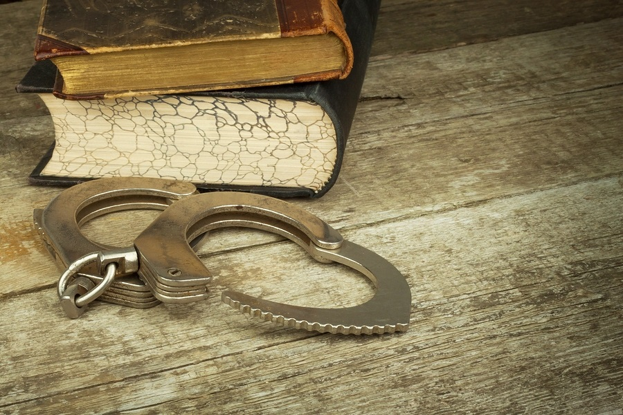 photo of books and handcuffs