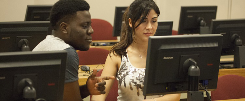 A male and female student working on computer