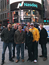 Students standing in front of Nasdaq