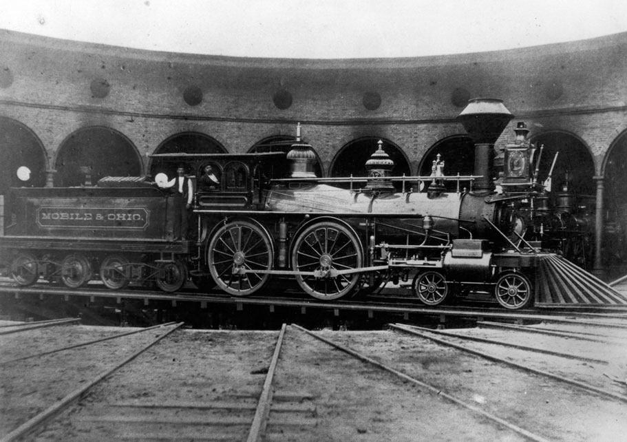 A Mobile & Ohio engine sits at the Whistler, Alabama, roundhouse in the 1880s.