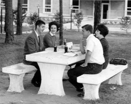 A group of 1966 USA students relaxes between classes.