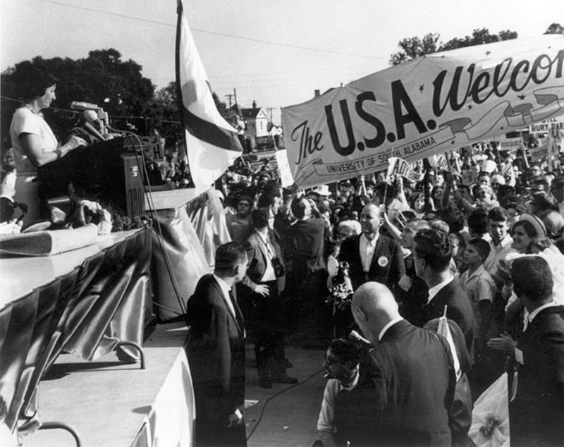 A crowd greets Lady Bird Johnson upon her arrival in Mobile during her husband's 1964 presidential campaign.