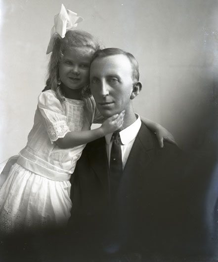 This beautiful image, presented in honor of Father's Day, shows a young girl with her arm across her father's shoulder and her other hand lightly caressing his face.