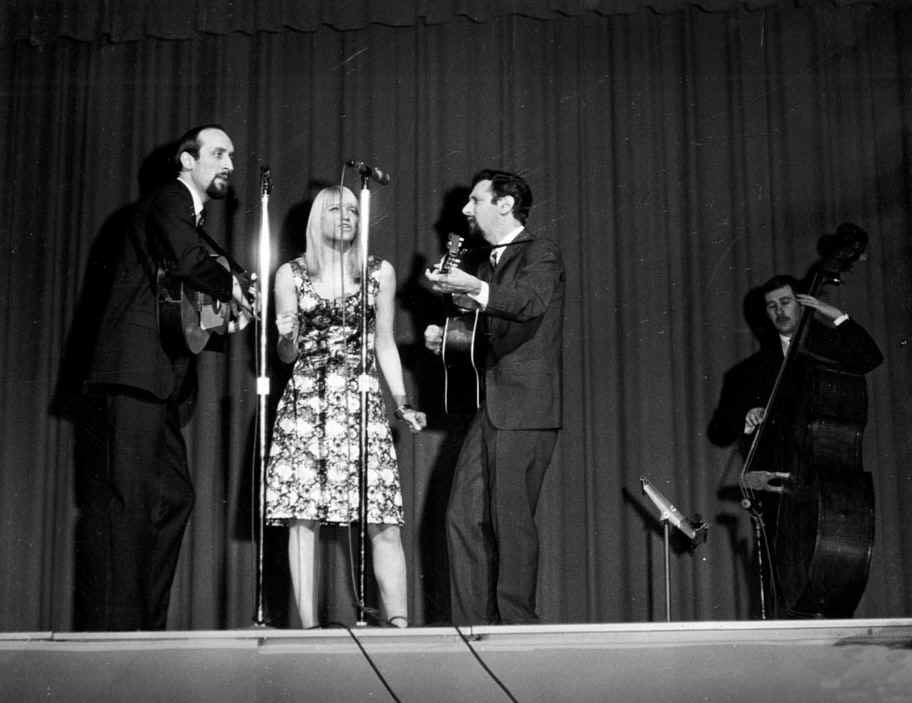 The singing group Peter, Paul, and Mary entertain members of the USA family, 1964.