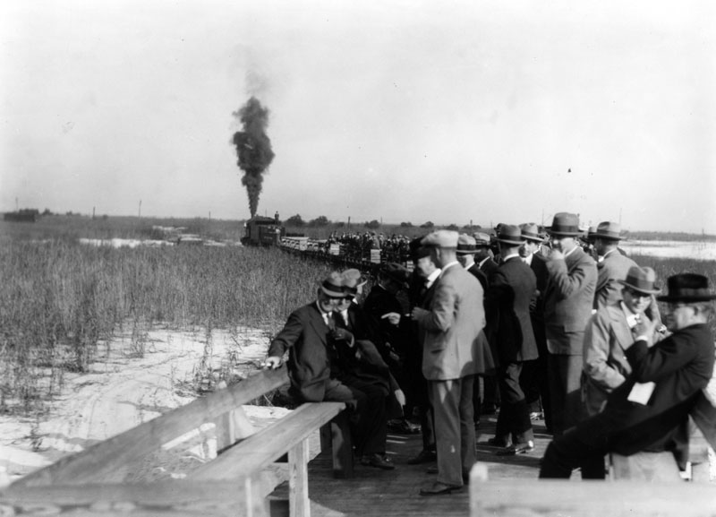 A group of men relax as a train takes them away from what was probably the dedication of the Alabama State Docks in the late 1920s.