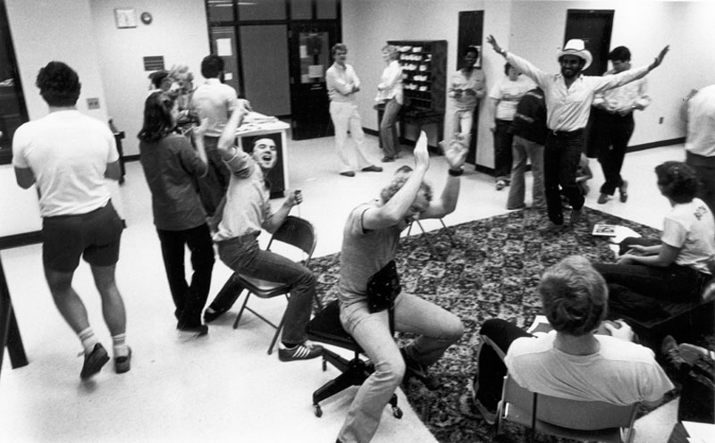 Students celebrate the results of the SGA elections inside the student center, April 24, 1980.