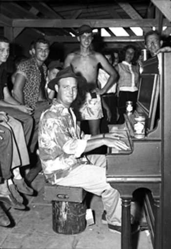 Edgar Dees Sr. plays for the crowd at an early 1950s Alabama Deep Sea Fishing tournament in Dauphin Island, Alabama.