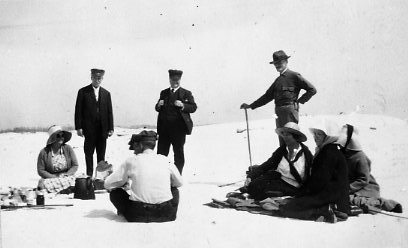 July 2014 Group picnicking at a beach along the Gulf, c. 1900.