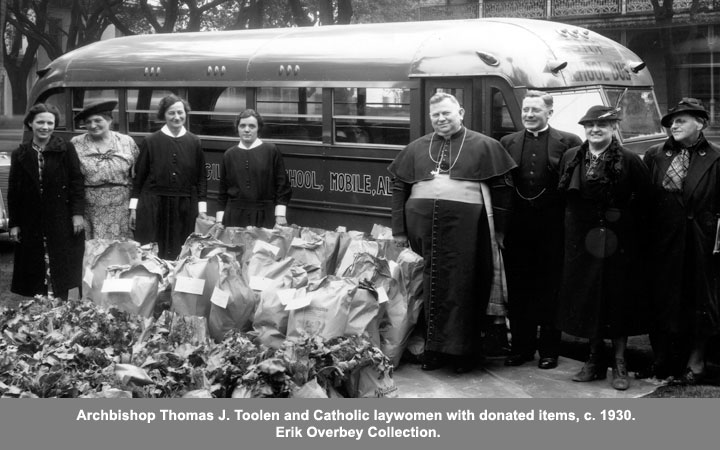 Archbishop Thomas J. Toolen and Catholic laywomen with with donated items, c. 1930.