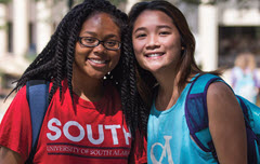 TWo female students in South shirts smiling
