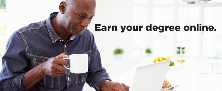 Man drinking coffee working on laptop with caption Earn Your Degree Online