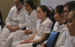 Group of nurses sitting in chairs
