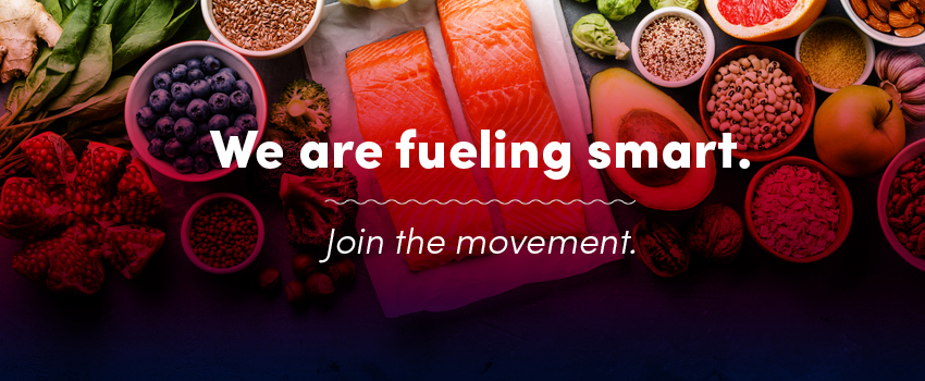 Fruit and fish on a table with the words We are fueling smart. Join the movement overlay on top.