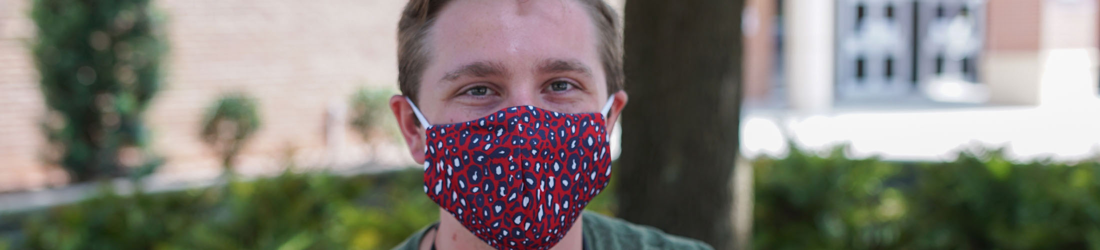 Male student with jag print mask on.