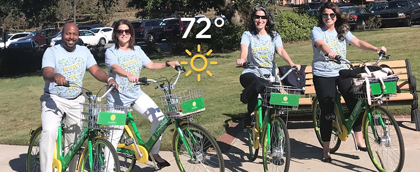 4 faculty sitting on Limebikes with 72 degrees written on top